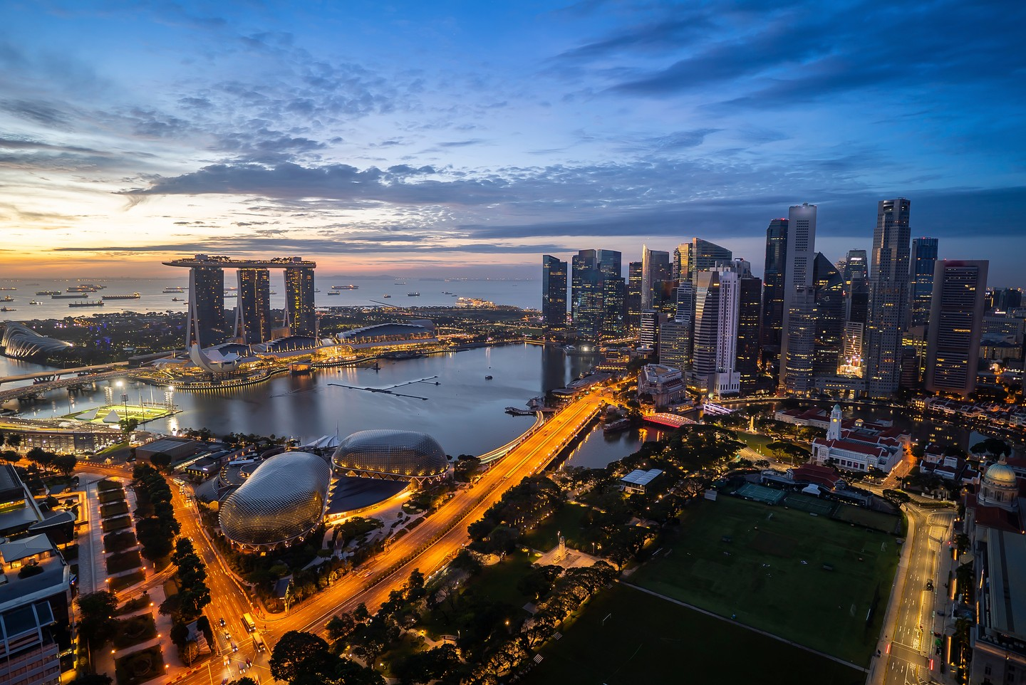 Aerial view of dramatic sunrise at Singapore city skyline